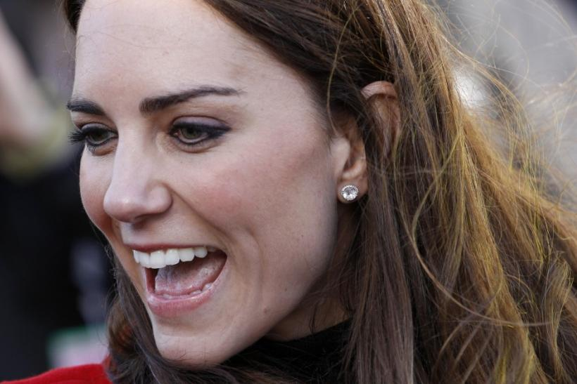 The fiancee of Britain's Prince William, Kate Middleton, smiles during their visit to St. Andrews University, in Fife