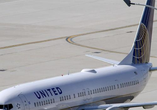 A United Airlines plane with the Continental Airlines logo on its tail, sits at a gate at O'Hare International airport in Chicago October 1, 2010