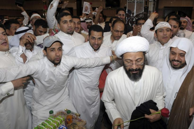Saudi Shi'ite cleric Tawfiq al-Amir (2nd R) is greeted by his supporters after his release in Al-Ahsa