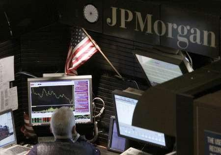 A trader works in the J.P. Morgan stall on floor of the New York Stock Exchange, September 14, 2009.