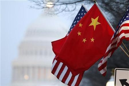 The People's Republic of China flag and the U.S. Stars and Stripes fly along Pennsylvania Avenue near the U.S. Capitol in Washington