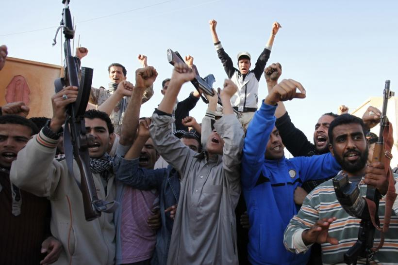 Libyans loyal to Libya's leader Muammar Gaddafi chant slogans in the town of Mizdah