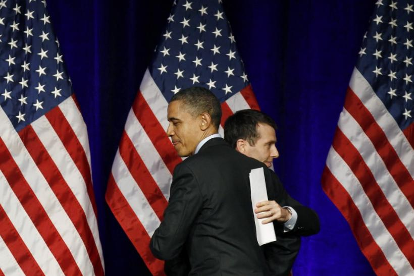 U.S. President Barack Obama gets a hug from senior advisor David Plouffe