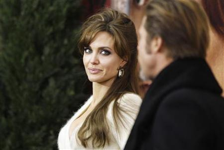 Cast member Angelina Jolie arrives with Brad Pitt for the premiere of ''The Tourist""