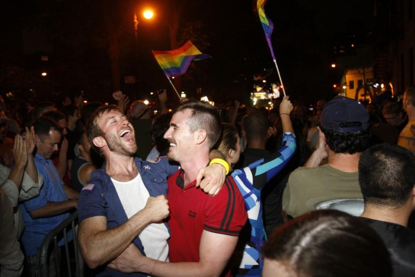 People celebrate after the New York Senate passed a bill legalizing gay marriage in New York