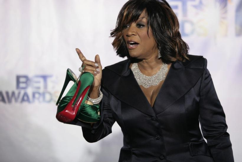 Patti LaBelle, winner of the lifetime achievement award, poses for photographers in a photo room as she holds her shoes at the 2011 BET Awards in Los Angeles, California, June 26, 2011.
