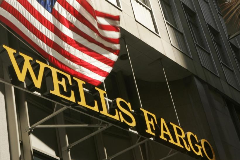 A U.S. flag flies above Wells Fargo & Co headquarters i