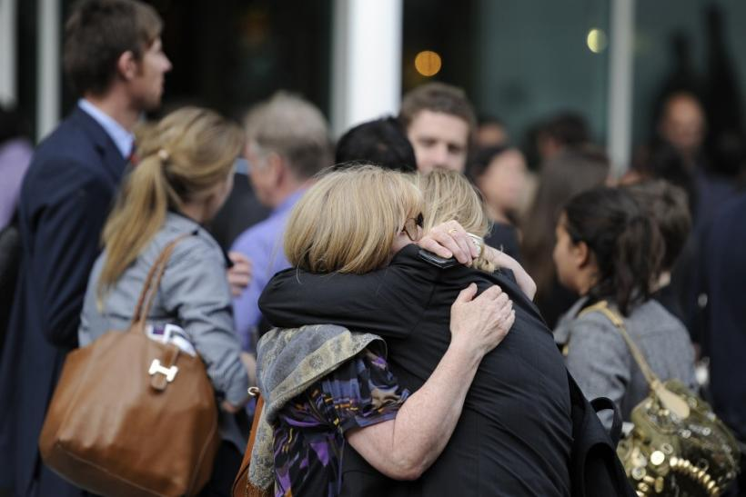 Two members of The News of The World staff hug outside a public house close to News International offices in Wapping