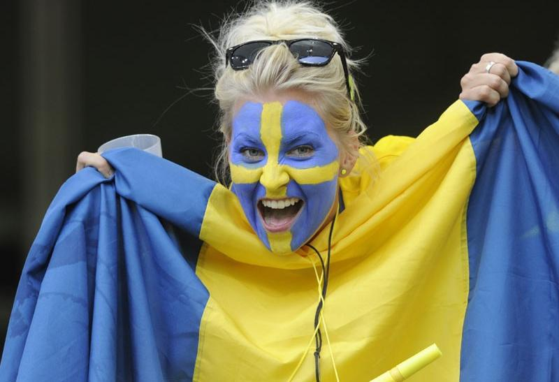 Sweden's fan cheers the team