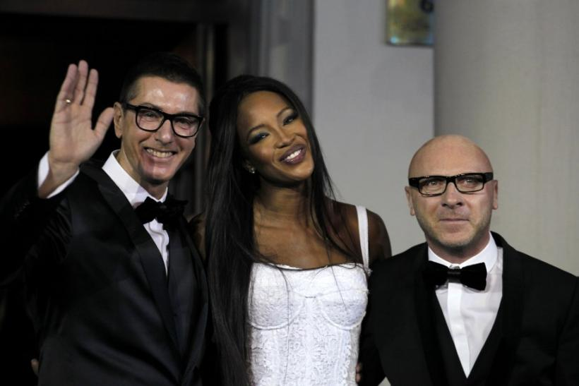 British model Naomi Campbell (C) smiles next to Italian designers Domenico Dolce (R) and Stefano Gabbana during a party marking the 25th anniversary of her career in downtown Shanghai October 28, 2010.  TOP 50 Best Fashion Designers TOP 50 Best Fashion Designers 127820 british model naomi campbell c smiles next to italian designers domeni