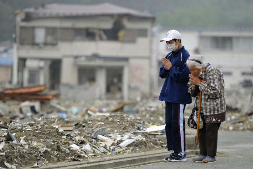 Yae Kubota and her grandson pray for the victims of the earthquake and tsunami in Miyako, Iwate prefecture