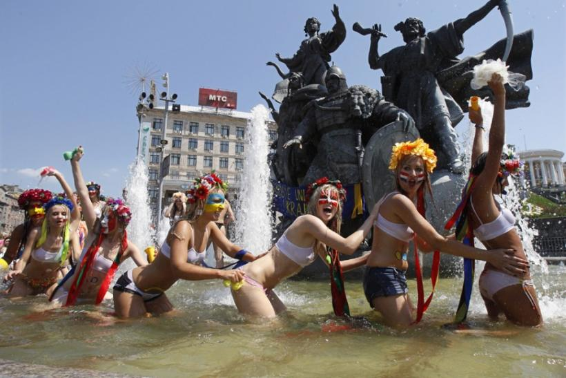 "Activists from ""Femen"" stage a protest in a fountain"