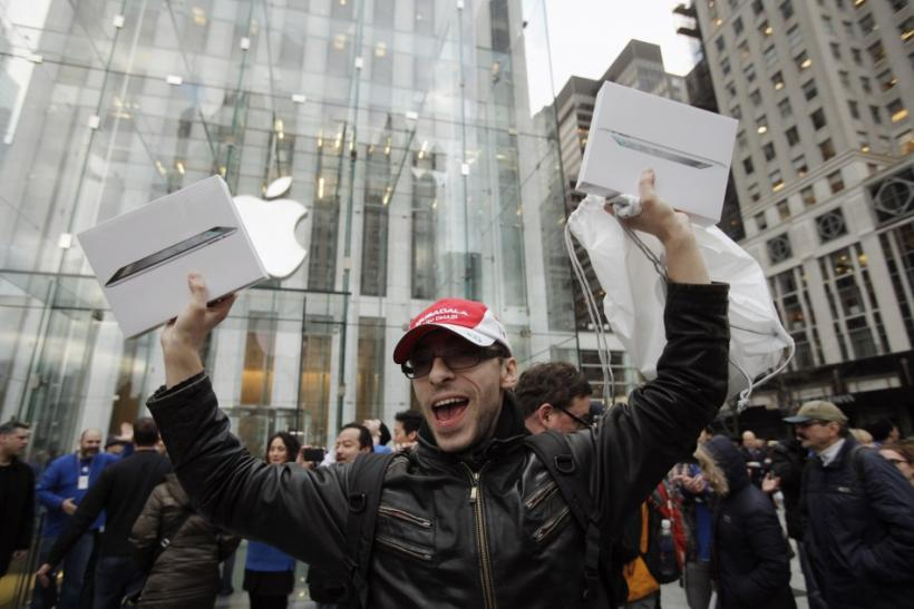 A customer holds up a pair of Apple's iPad 2