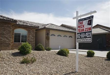 A real estate sales sign sits outside of a house for sale in Phoenix, Arizona