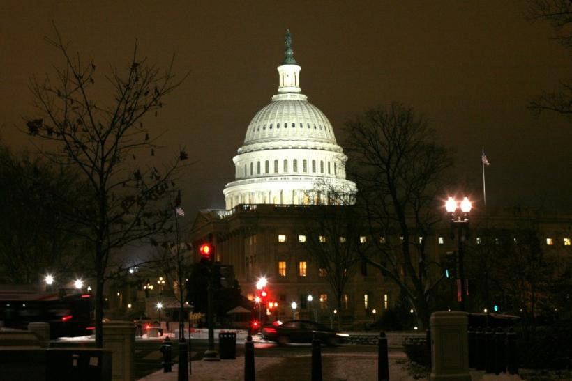 The U.S. Capitol Dome is lit after the first significant snowfall of the season as the House of Representatives worked late into the evening to pass the $858 billion package of renewed tax cuts and more unemployment benefits in Washington
