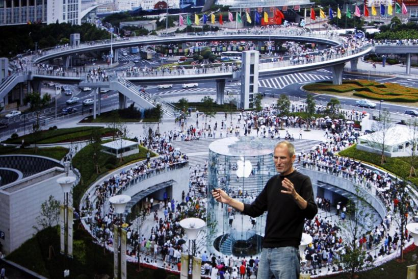 Apple Chief Executive Steve Jobs speaks on stage, with the Shanghai Apple store displayed on screen, at Apple's music-themed September media event in San Francisco, California
