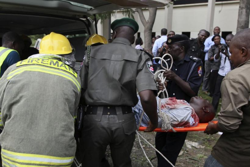 A victim of a bomb blast that ripped through the United Nations offices in the Nigerian capital of Abuja is loaded into an ambulance