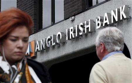 Pedestrians walk past a branch of Anglo Irish Bank in Dublin
