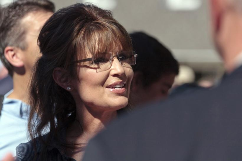 "Former Alaska governor Sarah Palin greets supporters as she arrives for the premiere of a documentary about her entitled ""The Undefeated"" in Pella, Iowa"