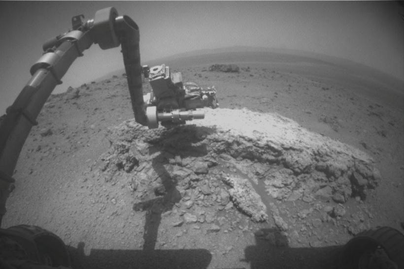 "NASA's Mars Exploration Rover Opportunity used its front hazard-avoidance camera to take this picture showing the rover's arm extended toward a light-toned rock, ""Tisdale 2"""