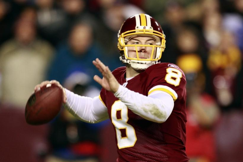 Washington Redskins quarterback Rex Grossman throws during first half against the New York Giants in their NFL football game in Landover