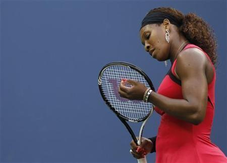 Serena Williams of the U.S. reacts to a missed point to Samantha Stosur of Australia during their finals match at the U.S. Open tennis tournament in New York