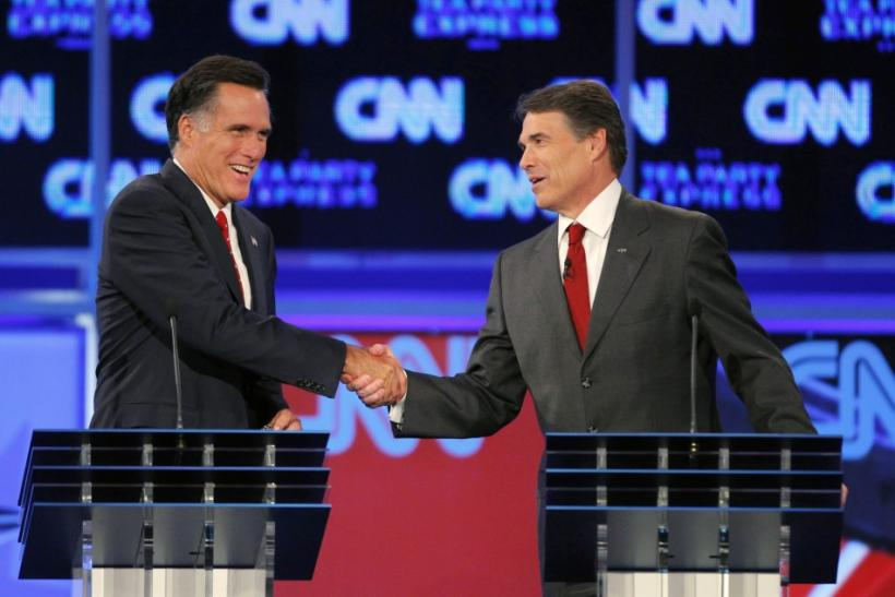 Romney (L) and Texas Governor Rick Perry shake hands at the conclusion of the CNN/Tea Party Republican presidential candidates debate in Tampa