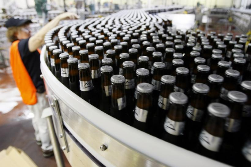 Thousands of newly-labelled bottles of Coors Light beer head for packaging at the Coors brewery in Golden, Colorado
