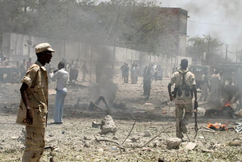 Somalia government soldiers secure the scene of a suicide attack in Somalia's capital Mogadishu