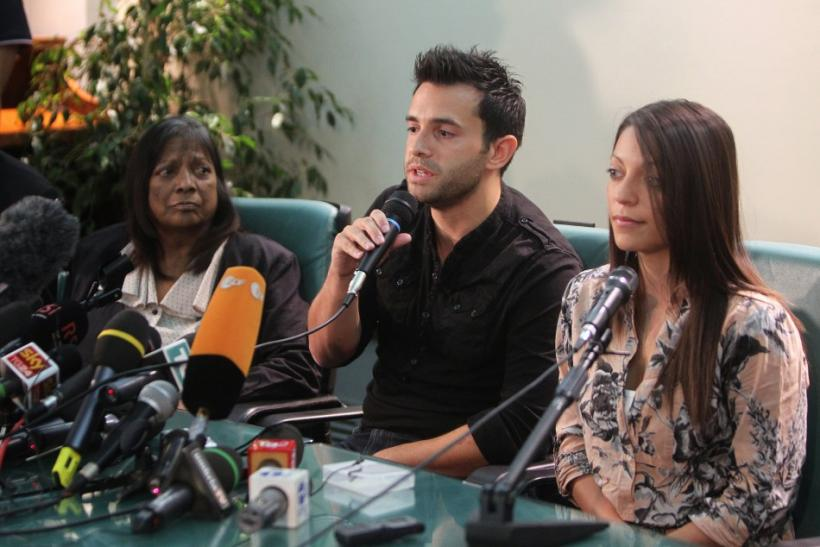 British student Meredith Kercher's family members, mother Arline, brother Lyle and sister Stephanie, attend a news conference in Perugia