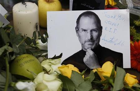 Tributes to the late Steve Jobs are left outside the Apple Store in London