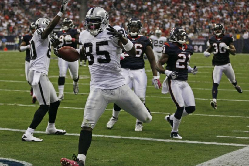 Oakland Raiders wide receiver Heyward-Bey crosses the goal line as he scores a touchdown against the Houston Texas during their NFL football game in Houston