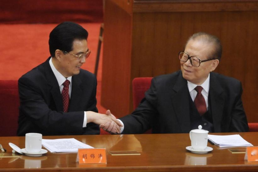 China's President Hu Jintao shakes hands with former President Jiang Zemin at the commemoration of the 100th anniversary of the Xinhai Revolution in Beijing