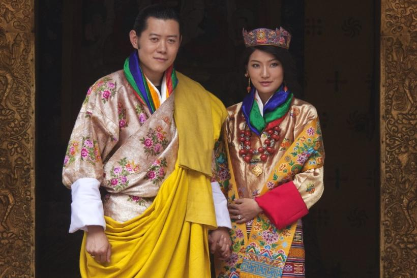 King Jigme Khesar Namgyel Wangchuck and Queen Jetsun Pema pose for pictures after their marriage at the Punkaha Dzong in Bhutan's ancient capital Punakha