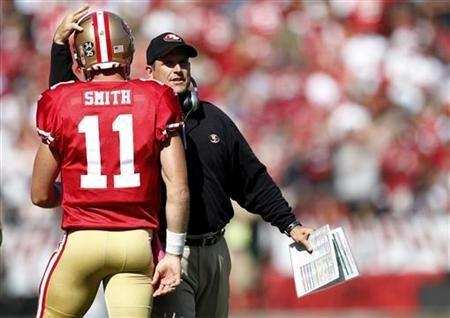 San Francisco 49ers head coach Jim Harbaugh (R) congratulates quarterback Alex Smith after a touchdown during the second quarter of their NFL football game against the Tampa Bay Buccaneers in San Francisco, California