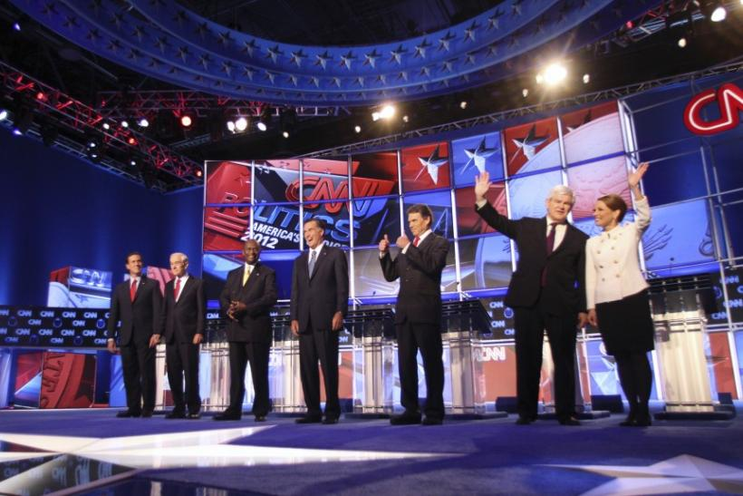 GOP presidential candidates (L-R) Rick Santorum, Ron Paul, Herman Cain, Mitt Romney, Rick Perry, Newt Gingrich and Michele Bachmann during the CNN Debate, moderated by Anderson Cooper.