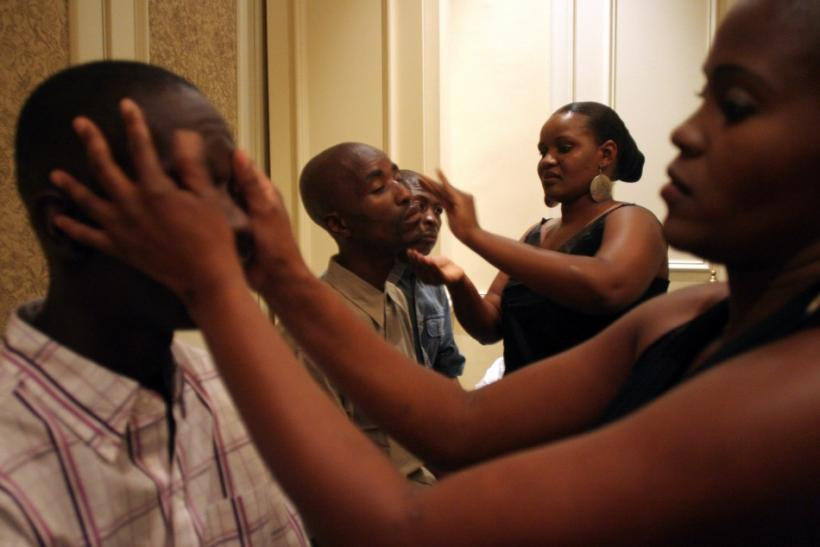 "Contestants have make up applied before the judging round in Botswana's ""Mr. HIV Positive Living 2006"" pageant in Gaborone"