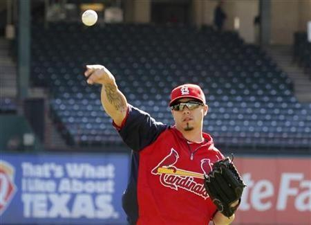 St. Louis Cardinals starting pitcher Kyle Lohse throws during practice a day prior to Game 3 of MLB's World Series baseball championship in Arlington, Texas