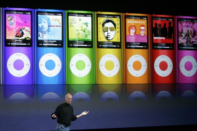 "Apple Inc CEO Steve Jobs speaks as colorful redesigned iPod Nano are displayed at Apple's ""Let's Rock"" media event in San Francisco, California September 9, 2008."