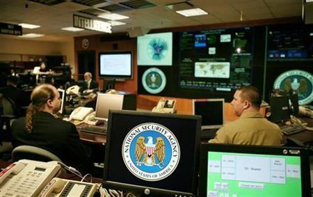 The National Security Agency (NSA) logo is shown on a computer screen inside the Threat Operations Center at the NSA in Fort Meade, Maryland