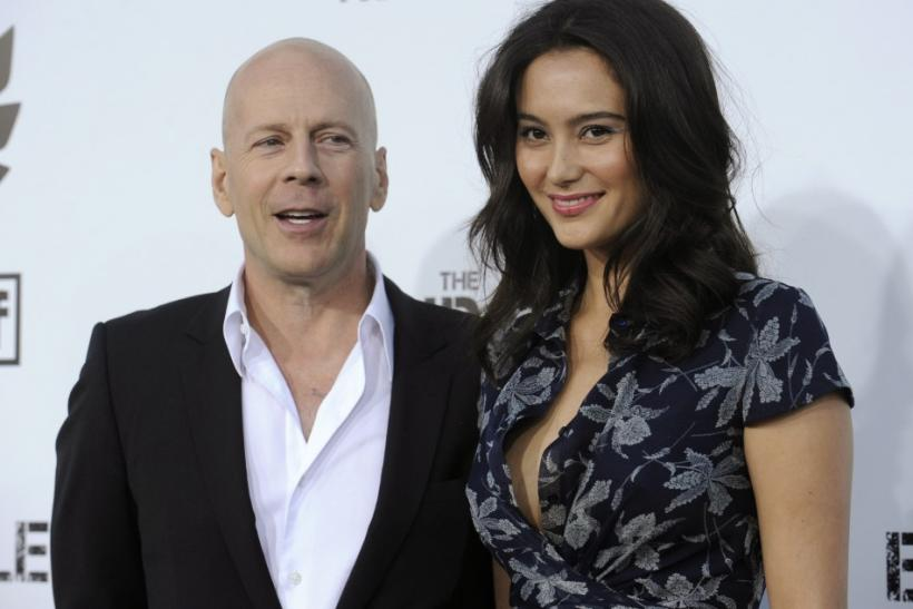 "Bruce Willis and Emma Heming attend the premiere of the film ""The Expendables"" in Los Angeles"