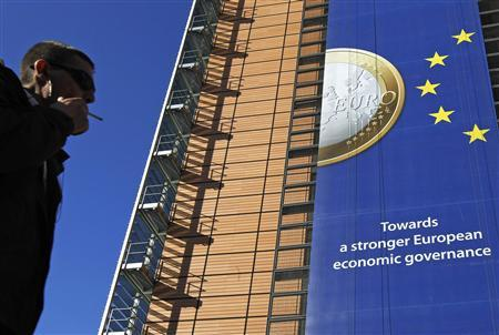 A banner featuring a Euro coin is seen on the European Commission headquarters building ahead of a European Union heads of state summit in Brussels