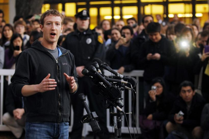 Mark Zuckerberg speaks to reporters at Harvard University in Cambridge