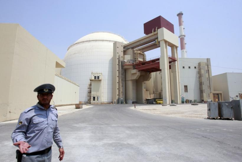 A security official talks to journalists in front of Bushehr main nuclear reactor