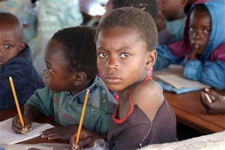 "Zambian children attend school in a poverty stricken area near the country""s capital Lusaka"