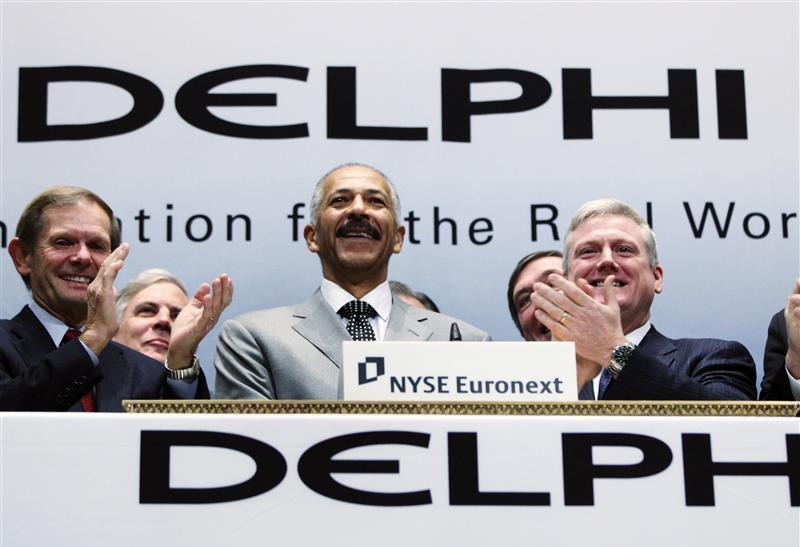 Rodney O'Neal, Chief Executive Officer of Delphi Automotive LLP, smiles after ringing the opening bell at the New York Stock Exchange