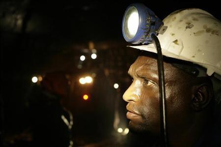 A mine worker looks on underground in Modderfontein east mine