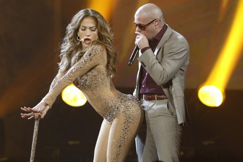 Singer Jennifer Lopez performs with rapper Pitbull at the 2011 American Music Awards in Los Angeles