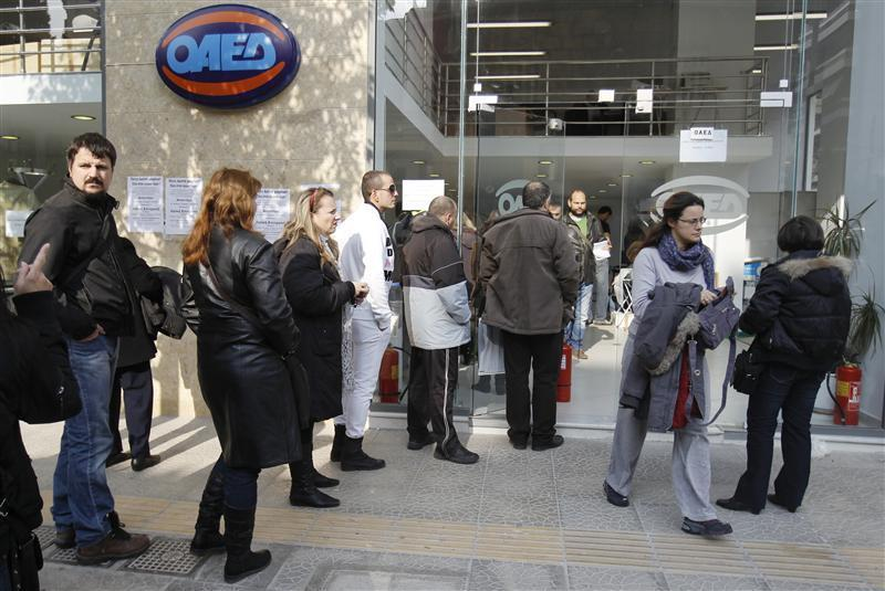 Jobless Greeks wait in line outside an unemployment bureau in Athens