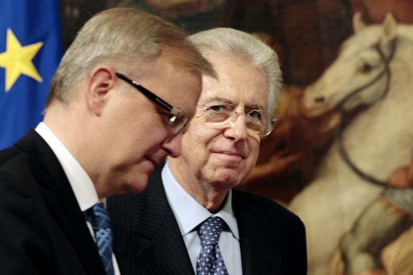 Italy's Prime Minister Mario Monti looks on as he meets European Union Economic and Monetary Affairs Commissioner Olli Rehn at the Chigi Palace in Rome